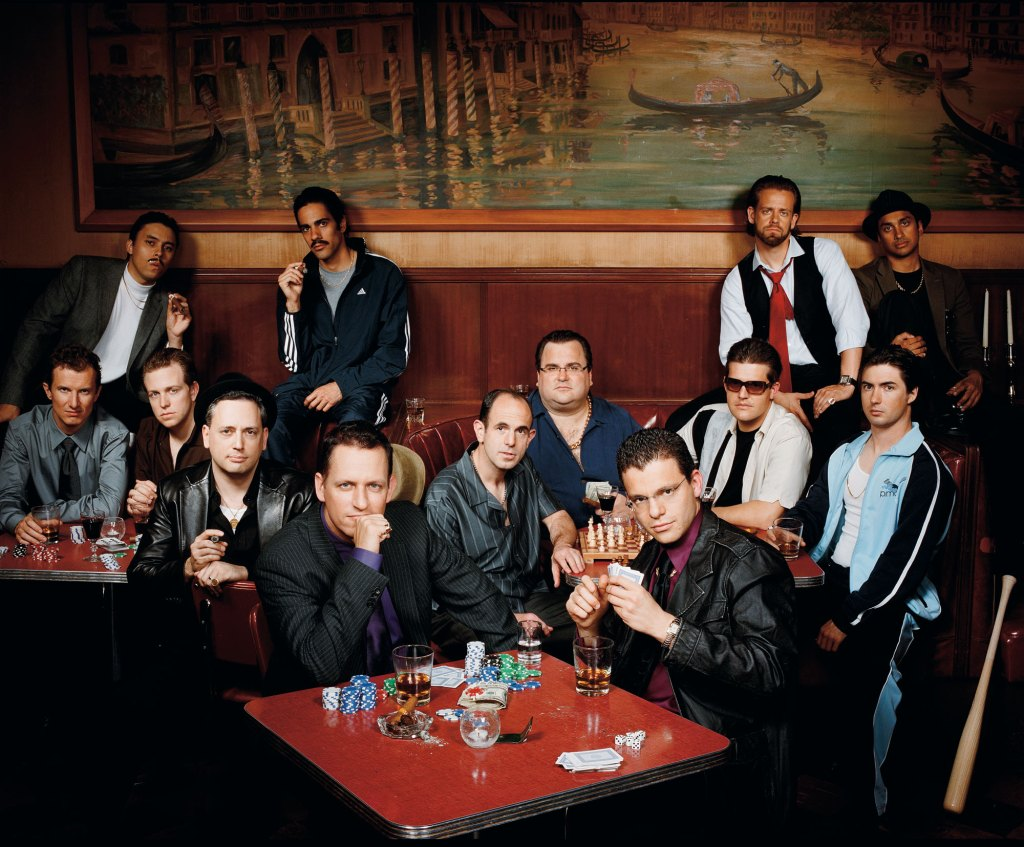"The ""paypal mafia"" photographed at Tosca in San Francisco, Oct, 2007. Back row from left: Jawed Karim, co-founder Youtube; Jeremy Stoppelman CEO Yelp; Andrew McCormack, managing partner Laiola Restaurant; Premal Shah, Pres of Kiva; 2nd row from left: Luke Nosek, managing partner The Founders Fund; Kenny Howery, managing partner The Founders Fund; David Sacks, CEO Geni and Room 9 Entertainment; Peter Thiel, CEO Clarium Capital and Founders Fund; Keith Rabois, VP BIz Dev at Slide and original Youtube Investor; Reid Hoffman, Founder Linkedin; Max Levchin, CEO Slide; Roelof Botha, partner Sequoia Capital; Russel Simmons, CTO and co-founder of Yelp"